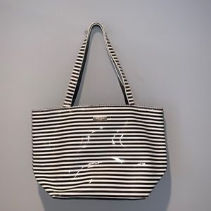 KATE SPADE BLACK AND WHITE STRIPED PURSE WITH BOW
